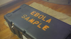 Carry carrying ebola sample container containment Stock Footage