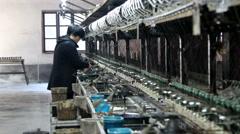 Woman working on a silk reeling machine Stock Footage