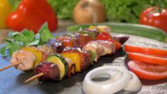 Grilled meat skewers on stone plate rotating Stock Footage