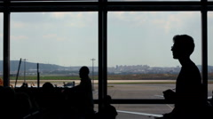 people waiting for the fly in the airport - stock footage