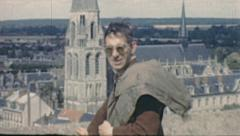 Vendôme 1949: man portrait with the Abbaye de la Trinité in the background Stock Footage