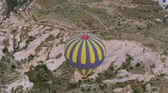 The Hot air balloon flying over rock landscape at Cappadocia Turke Stock Footage