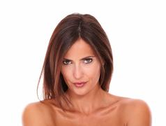 headshot portrait of young seductive latin woman with brown eyes looking at c - stock photo