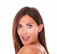 head and shoulders portrait of shocked adult woman showing her good facial ca - stock photo
