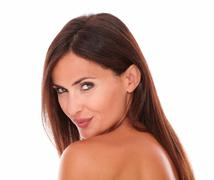 head and shoulders portrait of sexy mature woman with seductive look with nud - stock photo