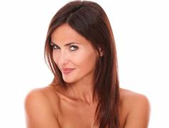 head and shoulders portrait of pensive sexy woman looking at camera with sens - stock photo
