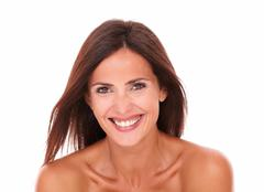 head and shoulders portrait of happy beautiful woman for body care laughing a - stock photo