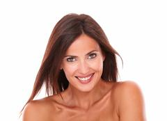 head and shoulders portrait of adult hispanic female smiling at camera on iso - stock photo