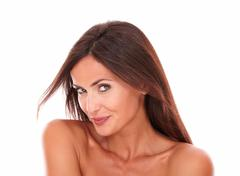 head and shoulders portrait of sexy hispanic female smiling at camera with he - stock photo