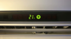 An air conditioner, opening, shows the temperature, close up Stock Footage