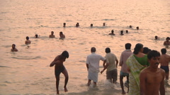 People swimming at the beach at Rameswaram in Tamil Nadu, India Stock Footage