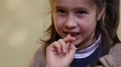 Cute  girl with the tooth that dangles by her hand Stock Footage