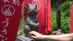 Petting The Bunny Statue For Good Luck Mt Kachi Kachi Shinto Shrine 02 4K Stock Footage