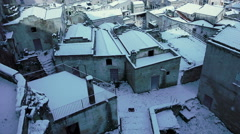 Snowy roofs of Matera, Italy Stock Footage