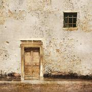 Old wall with wooden door and small window Stock Illustration