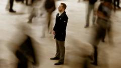 one person standing on crowded street. man thinking background. time lapse - stock footage