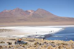 People at the mountain lake in Eduardo Avaroa Park - stock photo