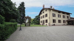 Italian villa in summer. Chapel twined with roses. Flycam, 4 shots in a sequence Stock Footage