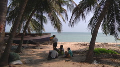 Man working near the boat at Rameswaram in Tamil Nadu, India Stock Footage