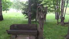Old wooden goat sculpture in resort park Stock Footage