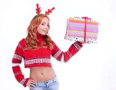Beautiful blonde woman with reindeer antlers Stock Photos