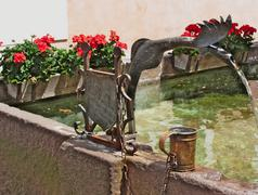 Stock Photo of detail of a copper spout of a fountain in the center of castelrotto (kastelru