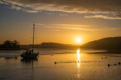 Sunrise on the river lynher with golden reflections at st germans, cornwall, uk - stock photo
