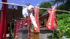 Prayer Scroll Tied To Rope In Front Of Flags At Shinto Shrine 4K Stock Footage