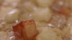 Potatoes Browning Being Fried in Oil Stock Footage