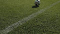 Soccer/football ball rolls at the pitch Stock Footage