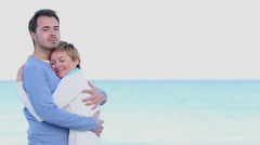 Young couple embracing on the beach Stock Footage