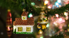 House toy on the New Year Tree with Santa on bg Stock Footage