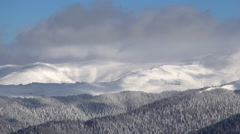 Beautiful winter time lapse, mountain plateau. Winter  day and gray clouds. Stock Footage