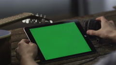 Musician Using Tablet PC in Landscape Mode at Home. Causal Lifestyle Stock Footage