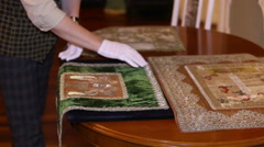 Worker lace museum exhibition shows rare instances. lace of gold and silver. Stock Footage