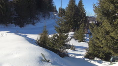 Mountain ski slope in a sunshine day. Winter landscape. Ski resort. - stock footage
