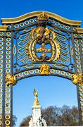 Gate with gilded ornaments in buckingham palace.  Stock Photos