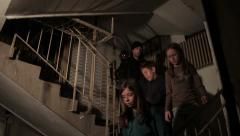Kidnappers take and close taken children in dark basement. Stock Footage