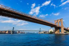 brooklyn and manhattan bridges east river ny - stock photo
