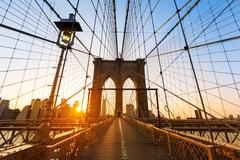brooklyn bridge sunset new york manhattan - stock photo