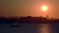NYC Sunset plan flyby over marina water near laguardia airport 1 Stock Footage