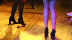 Young girl legs dancing on a disco dance floor Stock Footage