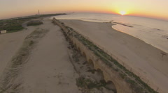 Sunset over the aqueduct in caesarea, Israel Stock Footage