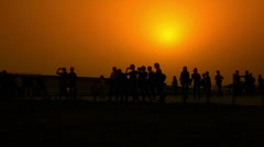 People Walking at sunset_wide Stock Footage
