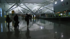 AIRPORT JFK New York INTERIOR NIGHT arrivals with Crew Walk Through Stock Footage