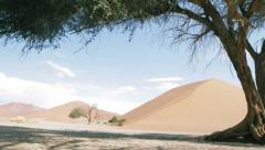 Lonely trees in desert of Sossusvlei sand dunes landscape, Namibia, Dolly Shot Stock Footage