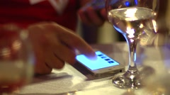 Using smart phone on a disco with wine glasses Stock Footage