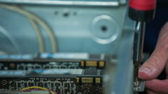 Stock Video Footage of Unscrewing computer graphic cards