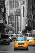 fift avenue neigbourhood yellow cab taxi 5 th av - stock photo