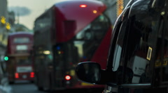 London street view, Cab in foreground, red buses passing by Stock Footage